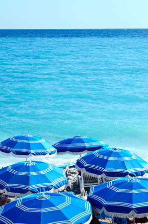Concept of holiday blue beach with parasols in Nice Stock Photo - 21694497