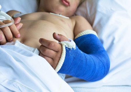 broken arm: Little sick boy in hospital coming out of surgery