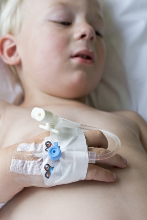 children's doctor: Little sick boy in hospital going for surgery Stock Photo