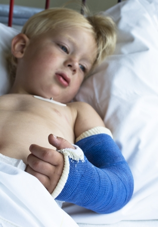 Little sick boy in hospital going for surgery Stock Photo - 21694618