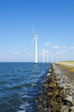 Alternative energy by windmills near water Stock Photo - 21695225