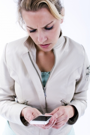 Isolated young woman with smartphone Stock Photo - 21695286