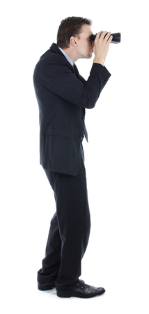 Businessman trying to forecast future economy while looking through binocular Stock Photo - 22428122