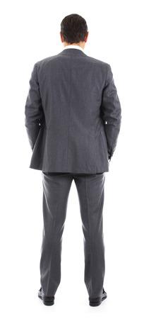 Homme d'affaires debout avec le dos � la cam�ra Banque d'images