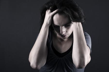 paranoia: depressed woman close-up Stock Photo