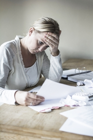 Woman with debt worried about bills to pay