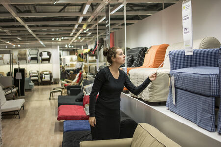 Woman shopping for indoor furniture