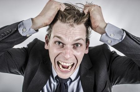 Üzletember, kiment a fejéből Stock fotó