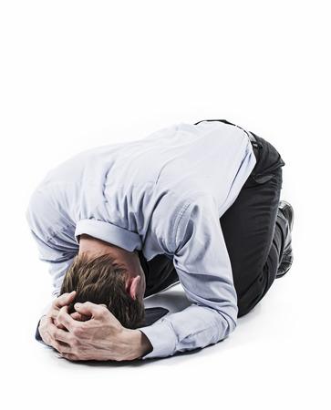 Man op de vloer Desperate positie Faillissement Stockfoto