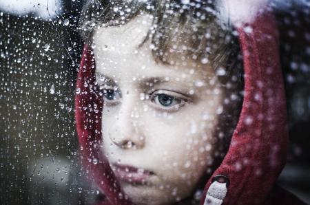 Depressief kleine jongen Stockfoto