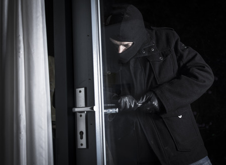 burglar breaking in house