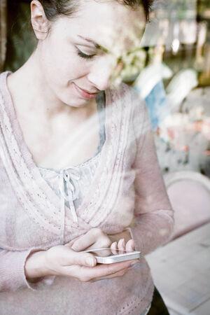 socialize: beatiful woman on smartphone  Stock Photo