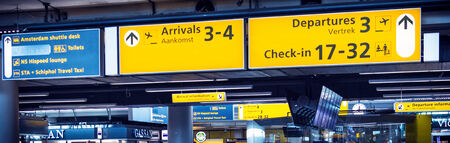 Departure and arrivals signing on airport departure hall
