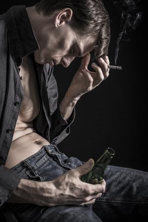 alcoholic man: Depressed man Stock Photo