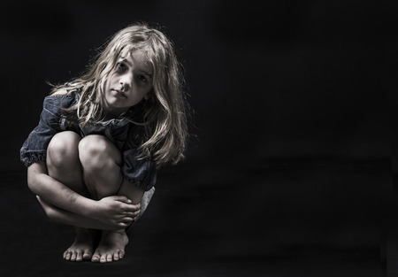 child abuse or homeless child photo
