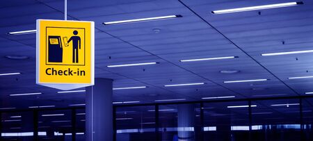 crowded space: Airport check-in sign Stock Photo