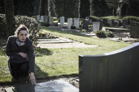 widow at gravestone photo