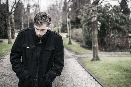 Depressed man walking outdoors  Sad and troubled mind Standard-Bild