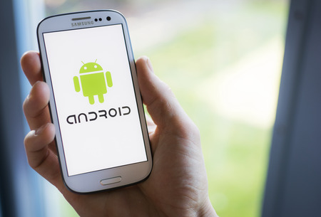 Samsung smartphone showing android logo.