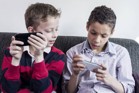 Kids gaming on smartphone photo