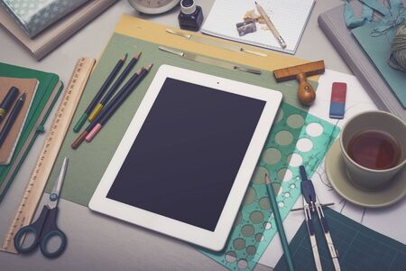 supply: Creative artist desk tablet PC mockup