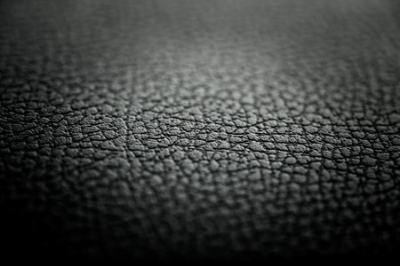 Black leather texture detail with shallow depth of field Stock Photo