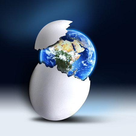 concept of planet earth breaking the egg shell Imagens