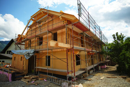 house under construction: wooden house under construction with scaffold