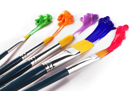 spot the difference: painting brushes and oil colors Stock Photo
