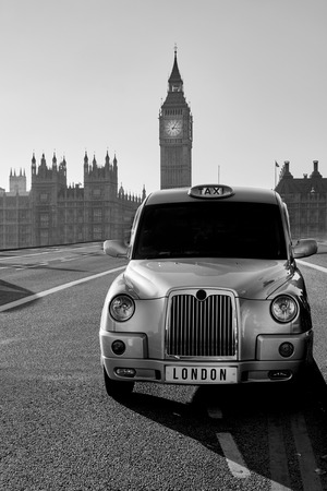 hackney carriage: Vintage London Taxi Cab in the city. Editorial
