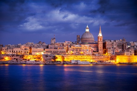 waterfront: City of Valletta Malta at Sunset captured from Silema Bay.