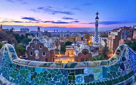 Park Guell In Barcelona Spain at Sunrise with Gaudi Architecture.