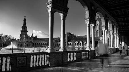 Seville, Spain - 10 February 2020 : Black and White Photography of Plaza de Espana Spain Square Architecture view from the inner corridor with columns in Beautiful Seville Spain City Center