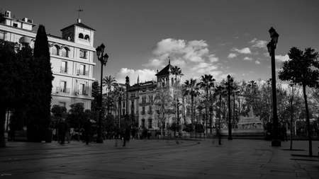 Seville, Spain - 10 February 2020 : Black and White Photography of Architecture on the Main Boulevard in Beautiful Seville Spain City Center