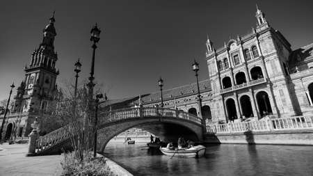 Seville, Spain - 10 February 2020 : Black and White Photography of Plaza de Espana Spain Square Architecture Bridge View over the Canal in Beautiful Seville Spain City Center