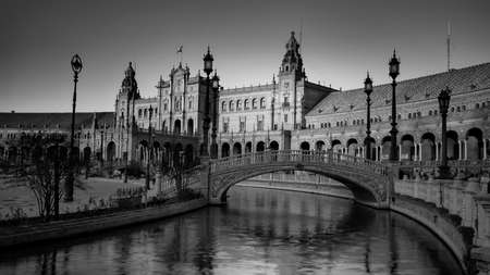 Seville, Spain - 10 February 2020 : Black and White Photography of Plaza de Espana Spain Square Architecture Bridge View Sunset over the Canal in Beautiful Seville Spain City Center