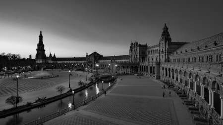 Seville, Spain - 10 February 2020 : Black and White Photography of Plaza de Espana Spain Square Architecture Wide angle View Sunset in Beautiful Seville Spain City Center