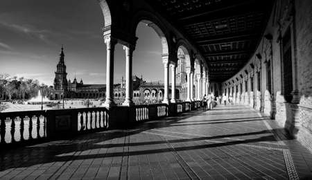 Seville, Spain - 10 February 2020 :Black and White Photography of Plaza de Espana Spain Square Architecture view from the inner corridor with columns in Beautiful Seville Spain City Center