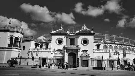 Seville, Spain - 10 February 2020 :Black and White Photography of Plaza de Toros with Tourists waiting to visit in Beautiful Seville Spain City Center