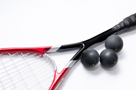Closeup of Squash racket isolated on white with balls Stock Photo