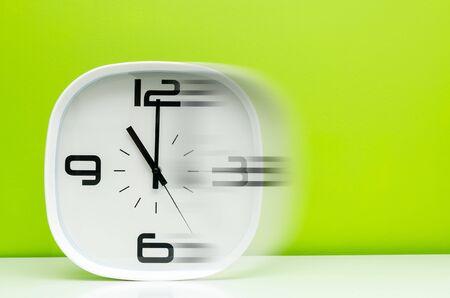 timezone: White clock on green background Stock Photo