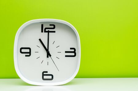 timezone: Modern white clock on green background isolated on green background