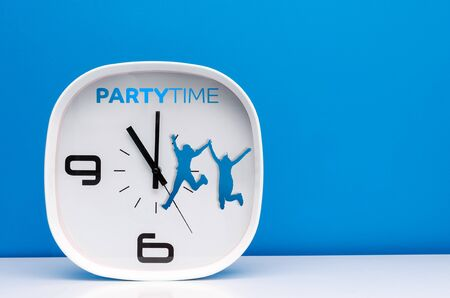 party time: Modern white clock on blue background with party time words Stock Photo