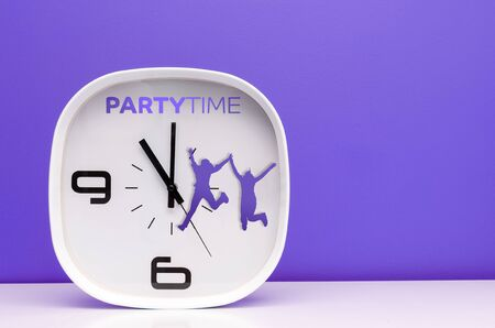 party time: Modern white clock on purple background with party time words Stock Photo