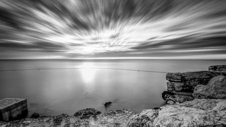 dramatic: Long exposure seascape with dramatic sky and smooth water