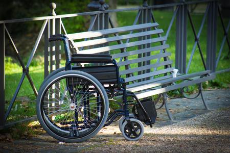 near: Wheelchair near the bench