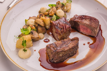 jams: Beef fillet with Madeira sauce on a big round plate