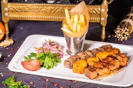brazier: A shish kebab from chicken, a shish kebab from mutton and a shish kebab from veal, fried on coals