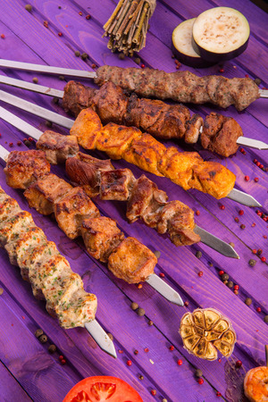 brazier: A shish kebab on skewers with fried vegetables and spices Stock Photo