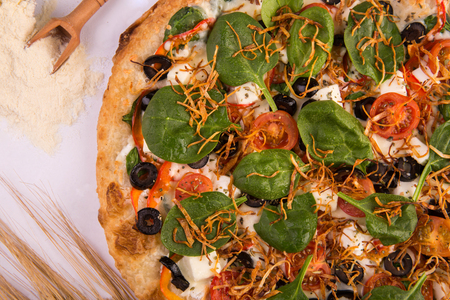 Cheese Greece pizza feta, spinach, sweet pepper, cheese sauce Stock Photo